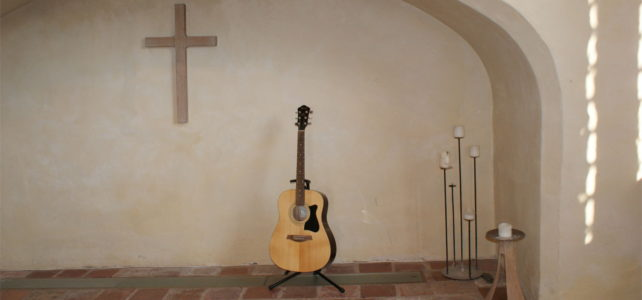 Guitar with wooden cross in St Lawrence hall
